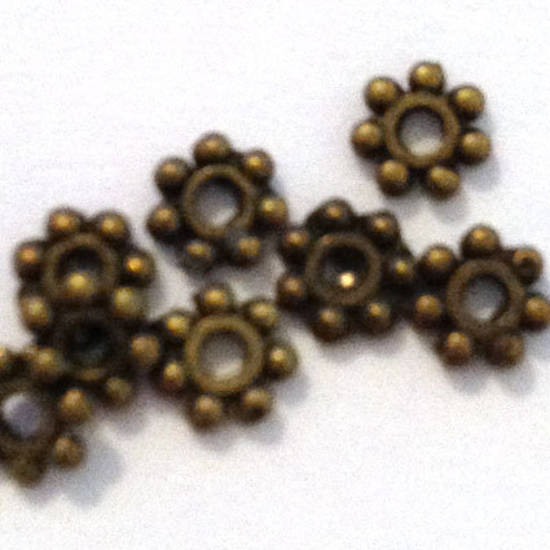 Metal Spacer: 4mm flower edge - brass