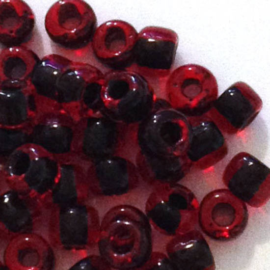 Miyuki size 8 round: 324 - Transparent Rred lined with darker red