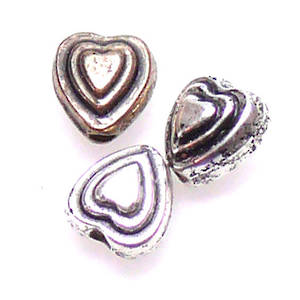 Acrylic heart with ridged edges.