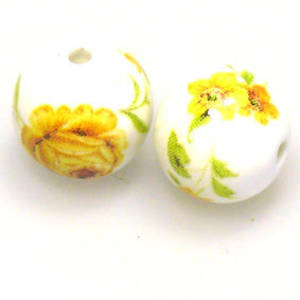 Porcelain Round Bead, 12mm. Yellow and green flower and leaf pattern.