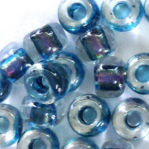 Miyuki size 6 round: 766 - Clear, lined with blue/green shimmer